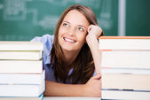 Smiling Teacher With Stack Of Books Looks Up — Stock Photo