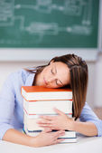 Teacher Sleeping On Stack Of Books At Desk — Stock Photo