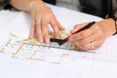 Woman drawing on plan — Stock Photo