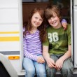 Boy And Girl In A Caravan — Stock Photo