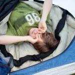 Boy Sleeping In Sleeping Bag — Stock Photo