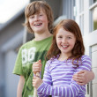 Boy And Girl Standing Together At Entrance Of Camping Houses — Stock Photo #25976207