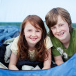 Brother And Sister Lying In Tent — Stock Photo #25977387