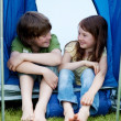 Brother And Sister Sitting In Front Of A Tent — Stock Photo