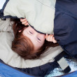 Portrait Of Little Girl Lying In Sleeping Bag — Stock Photo