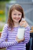 Girl With Milk Bottle At Campsite — Stock Photo