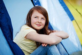 Smiling Girl Looking Up While Sitting In Tent — Stock Photo