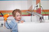 Boy Using Hair Dryer In Bathroom — Stock Photo