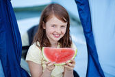 Girl Holding Slice Of Watermelon Against Tent — Stock Photo