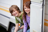 Two Kids Sitting In Doorway Of RV — Stock Photo