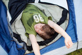 Young Tired Boy Sleeping In Tent — Stock Photo