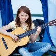 Young Girl Playing Guitar Against Tent — Stock Photo