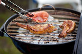 Meat And Tongs On Barbecue — Stock Photo