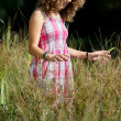 Stock Photo: Girl Standing In Tall Grass At Park