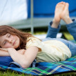 Girl Sleeping On Blanket With Tent In Background — Stock Photo