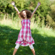 Teenage Girl With Arms Raised Jumping In Nature — Stock Photo