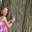 Stock Photo: Young scientist looking at tree