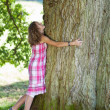 Teenage Girl Embracing Tree — Stock Photo