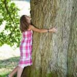 Teenage Girl Embracing Tree — Stock Photo #25995663