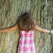 Rear View On Girl Embracing A Tree — Stock Photo #25995733