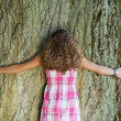 Rear View On Girl Embracing A Tree — Stock Photo