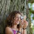 Girl Looking At Leaf Through Magnifying Glass At Park — Stock Photo