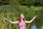 Girl With Arms Outstretched At Park — Foto Stock