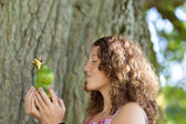 Teenage Girl Kissing Toy Frog Against Tree Trunk — Stock Photo