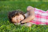 Sleeping Teenage Girl Lying On Grass — Stock Photo