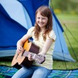 Smiling Girl Playing Guitar Against Tent — Stock Photo