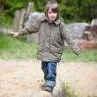 Young Boy Walking On Wood At Park — Stock fotografie