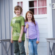 Siblings Standing Together At Entrance Of Camping Houses — Stock Photo