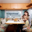 WomWith Sons Reading Story Book At Table In Caravan — Stock Photo #26005403