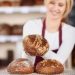 Waitress Keeping Breads On Napkin At Bakery Counter — Stock Photo