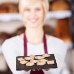 Waitress Holding Bread Tray In Cafe — Stock Photo
