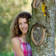 Young Girl Embracing Tree In Park — Stock Photo