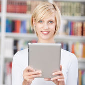 Female Student Holding Digital Tablet In Library — Stock Photo