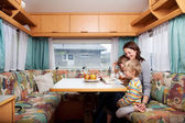 Woman With Sons Reading Story Book At Table In Caravan — Stock Photo