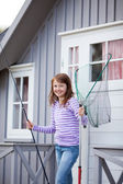 Girl Holding Fishing Net And Rod — Stock Photo