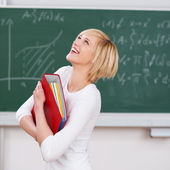 Student With Binder Looking Up Against Chalkboard — Stock Photo