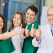 Team Of Doctors Gesturing Thumbs Up Sign — Stock Photo