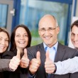 Businesspeople Showing Thumbs Up Sign — Stock Photo #26010571