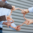 Stock Photo: Businessteam Joining Fingers Against Shutter