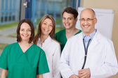 Happy Doctor Team Standing Together In Clinic — Stock Photo