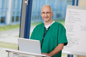 Confident Mature Surgeon Standing At Podium — Stock Photo