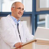 Doctor Looking Away At Podium — Stock Photo