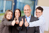 Businesspeople With Thumbs Up Sign In Office — Stock Photo