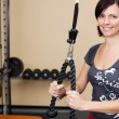 Stock Photo: Young attractive brunette woman in the gym