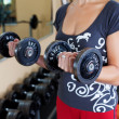 Stock Photo: Womwith dumbbell
