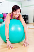 Woman training with a gymnastics ball — Stock Photo